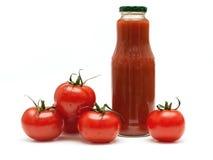 Pomodori e succo di pomodoro Immagine Stock Libera da Diritti