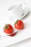 Pomodori ed acqua Immagini Stock Libere da Diritti