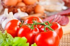 Pomodori ed altri alimenti Fotografia Stock