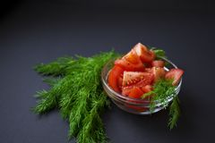 Pomodori ed aneto verde Immagine Stock
