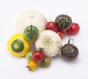 Pomodori misti con l'altra verdura Fotografie Stock