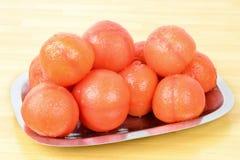 Pomodori sbucciati Immagini Stock