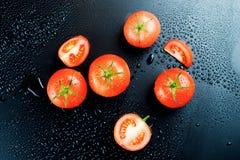 Pomodori su fondo nero Immagini Stock
