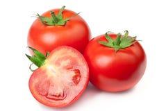 Pomodori su priorità bassa bianca Immagini Stock Libere da Diritti