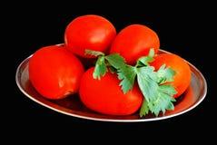Pomodori su un di piastra metallica Immagine Stock Libera da Diritti