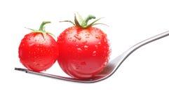 Pomodori sulla forcella Fotografie Stock