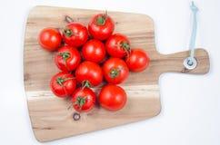 Pomodori sulla tabella di legno Immagine Stock Libera da Diritti