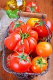 Pomodori in un canestro Immagine Stock Libera da Diritti