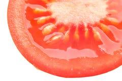 Pomodoro affettato, il suo nocciolo, il centro e semi. Immagini Stock Libere da Diritti