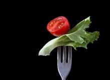 Pomodoro di ciliegia e foglio dell'insalata Immagini Stock