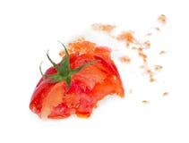 Pomodoro fresco schiacciato. Immagini Stock