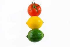 Pomodoro, limone e limetta - semaforo. Immagini Stock