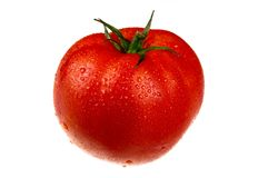 Pomodoro nelle gocce immagine stock