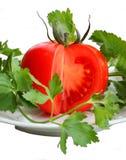 Pomodoro rosso e prezzemolo verde immagini stock