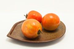 Pomodoro su priorità bassa bianca Immagini Stock