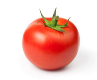 Pomodoro su una priorità bassa bianca fotografia stock