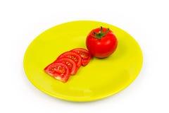 Pomodoro sul piatto verde Fotografia Stock Libera da Diritti