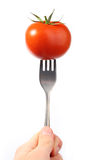 Pomodoro sulla forcella fotografie stock libere da diritti