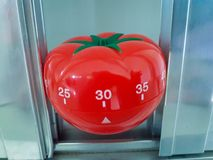 Pomodoro Timer in brushed metal with bold highlight and shadow royalty free stock image