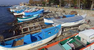 Autumn city of Pomorie in Bulgaria: boats and the sea stock video footage