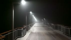 Small night rain on the pier in Pomorie, Bulgaria. Pomorie - famous resort town in Bulgaria. In summer it is a popular tourist destination, mainly from Russia stock video footage