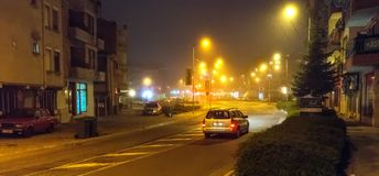Night misty street in the Bulgarian Pomorie stock photography