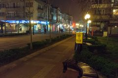 On the main street of a foggy night in the center of Pomorie, Bulgaria royalty free stock photos