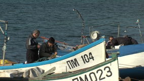 Pomorie fishermen before going out to sea, Bulgaria. Pomorie - ancient Bulgarian seaside town famous discoveries of ancient Slavic settlements. Located on the stock video footage