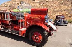 Pompe à incendie 1931 suburbaine d'ouvrier chargé des pompes de 500 gal/mn de Seagrave de rouge Photo libre de droits