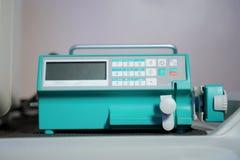Pompe de seringue avec le moniteur Image stock