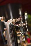Pompe della birra in una fila Fotografia Stock