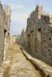 Pompei Road. Image of a narrow road leading through the ruins of Pompei, Italy Stock Photos