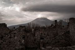 Pompei ruins and Vesuvius vulcan in the background. stock photo