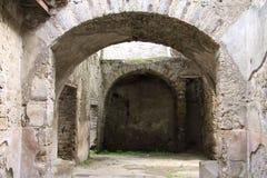 Pompeii. Ancient Roman corridor passing through arch in wall, Pompeii, Italy stock photography