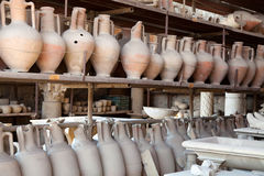 Pompeii antique pottery jugs. The city of Pompeii was an ancient Roman city. The eruption killed the city's inhabitants and buried it under tons of ash Royalty Free Stock Photography
