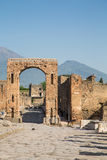 Pompeii Arch with Vesuvius in Background Stock Photography