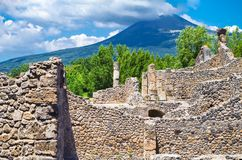 Pompeii, archeological site, Ancient ruins of dying town with view on smoking Mount Vesuvius. stock photography