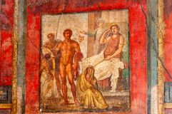 Pompeii, the best preserved archaeological site in the world, Italy. Frescoes on the interior wall at home destroyed by eruption royalty free stock image