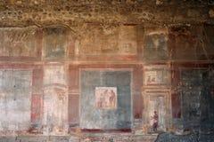 Pompeii, Italie Fresques antiques dans le mur du vieux bâtiment images stock