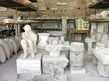 POMPEII, ITALY - May 06; Body of man preserved in plaster cast w Stock Photo