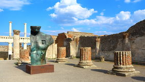 Pompeii, Italy: Mitoraj statue. Pompeii, Italy - March 28, 2017: Sculptures of the Polish sculptor Igor Mitoraj on display at Pompeii archaeological site, the Stock Image