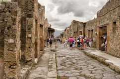 POMPEII, ITALY. Tourists visit Pompeii - an ancient Roman city that was ruined from the eruption of Mount Vesuvius in 79 AD Royalty Free Stock Photos