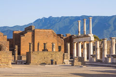 Pompeii landscape with mountains background. Pompeii scene with columns and ruins with the mountain as background, Italy Royalty Free Stock Images