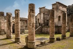 Pompeii ruins: Temple of Isis remains with ancient columns. Pompeii ruins: Temple of Isis with columns. Remains of the ancient Pompeii town destroyed by eruption stock photos