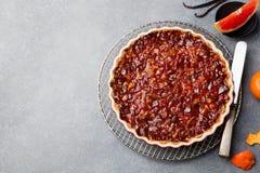 Pompelmo, arancia, crostata del limone, briciola in un piatto Fotografia Stock