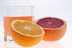 Pompelmo, arancio e spremuta Fotografia Stock Libera da Diritti