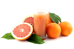 Pompelmo, arancio e spremuta. Fotografia Stock
