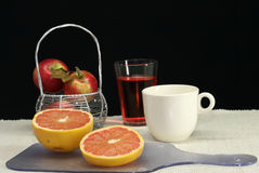 Pompelmo, caffè e spremuta Immagine Stock