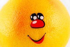 Pompelmo con un sorriso Immagini Stock