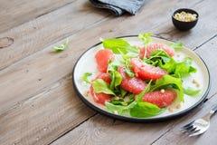 Pompelmo ed insalata della rucola Immagini Stock